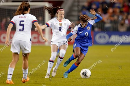 United States' midfielder Rose Lavelle (16) pressures Haiti forward Roseline Eloissaint (11) as defender Kelley O'hara (5) looks on during the first half of a women's Olympic qualifying soccer match, in Houston