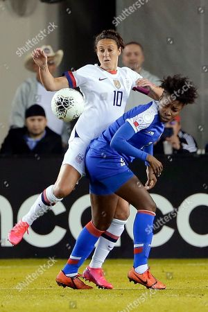 United States forward Carli Lloyd (10) and Haiti defender Soveline Beaubrun, right, collide as they go for the ball during the first half of a women's Olympic qualifying soccer match, in Houston