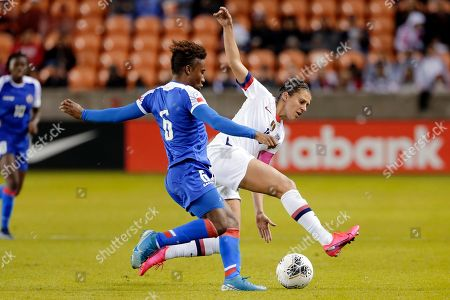 Haiti midfielder Melchie Dumonay (6) tries to move the ball past United States forward Carli Lloyd, right, during the second half of a women's Olympic qualifying soccer match, in Houston
