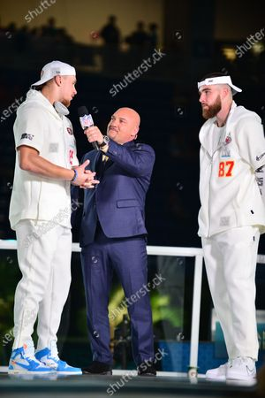San Francisco 49ers Tight end George Kittle (#85) and Kansas City Chiefs tight end Travis Kelce (#87) speak to sportscaster Jay Glazer (C) answers questions from the media at Marlins Park
