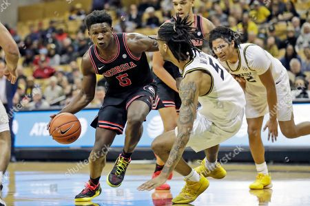 Georgia's Anthony Edwards (5) heads to the basket as Missouri's Mitchell Smith (5) defends during the first half of an NCAA college basketball game, in Columbia, Mo