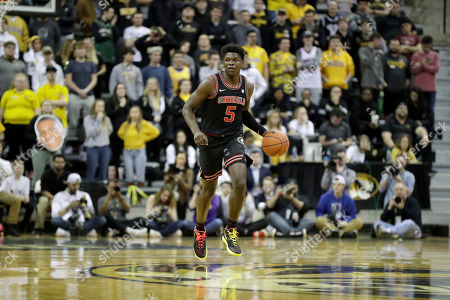 Georgia's Anthony Edwards brings the ball down the court during the first half of an NCAA college basketball game against Missouri, in Columbia, Mo