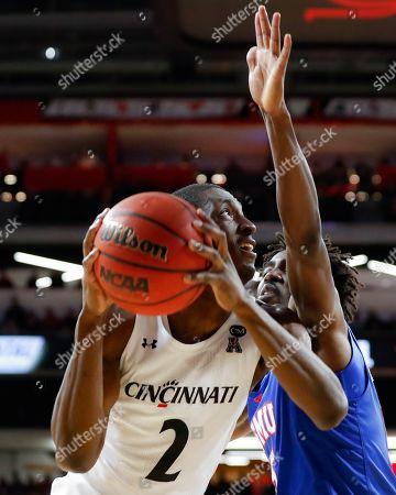 Keith Williams, Emmanuel Bandoumel. Cincinnati's Keith Williams (2) eyes the basket against SMU's Emmanuel Bandoumel (5) during the first half of an NCAA college basketball game, in Cincinnati