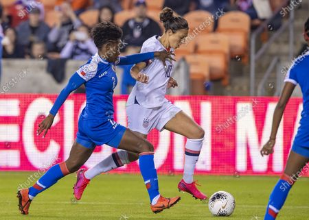 United States Women's Olympic Soccer forward Carli Lloyd (10) and Haiti Women's Olympic Soccer defender Soveline Beaubrun (2) during the first half of the CONCACAF Olympic Womenâ€s Qualifying match at BBVA Stadium in Houston, Texas. ©Maria Lysaker/CSM
