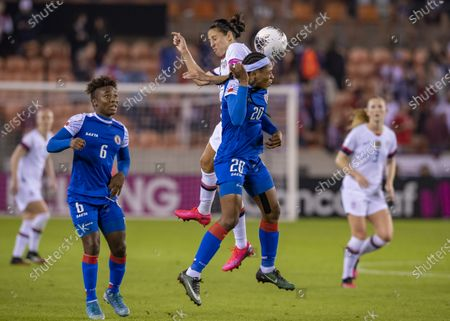 Haiti Women's Olympic Soccer defender Kethna Louis (20) and United States Women's Olympic Soccer forward Carli Lloyd (left) go up for the header in the CONCACAF Olympic Womenâ€s Qualifying match at BBVA Stadium in Houston, Texas. ©Maria Lysaker/CSM
