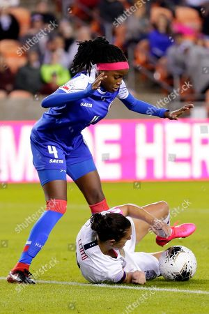 Haiti defender Ruthny Mathurin (10) avoids running over U.S. forward Carli Lloyd, right, during the second half of a women's Olympic qualifying soccer match, in Houston