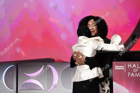 Shonda Rhimes, Cicely Tyson. Shonda Rhimes, right, hugs Cicely Tyson at the 25th Television Academy Hall of Fame on at the Television Academy's Saban Media Center in North Hollywood, Calif