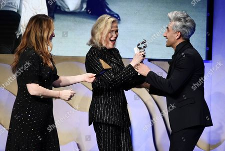 "Ana Gasteyer, Catherine O'Hara, Tan France. Actress Catherine O'Hara, center, a cast member in the television series ""Schitt's Creek,"" accepts the Excellence in Contemporary Television award for the show's costume designer Debra Hanson during the 22nd Annual Costume Designers Guild Awards at the Beverly Hilton, in Beverly Hills, Calif. Handing the award to O'Hara are presenters Ana Gasteyer, left, and Tan France"