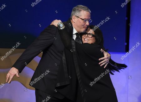 Adam McKay, Susan Matheson. Director Adam McKay, left, is embraced by costume designer Susan Matheson as he walks onstage to accept the Distinguished Collaborator Award during the 22nd Annual Costume Designers Guild Awards at the Beverly Hilton, in Beverly Hills, Calif