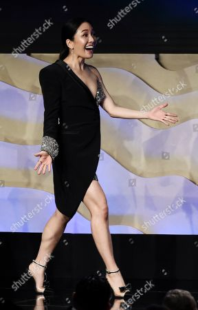 Constance Wu walks onstage during the 22nd Annual Costume Designers Guild Awards at the Beverly Hilton, in Beverly Hills, Calif