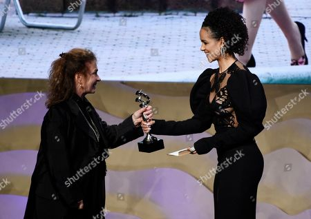 """Donna Zakowska, Nathalie Emmanuel. Costume designer Donna Zakowska, left, accepts the Excellence in Period Television Award for """"The Marvelous Mrs. Maisel"""" from actress Nathalie Emmanuel during the 22nd Annual Costume Designers Guild Awards at the Beverly Hilton, in Beverly Hills, Calif"""