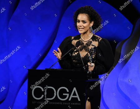 """Stock Picture of Nathalie Emmanuel, a cast member in the television series """"Game of Thrones,"""" accepts the Excellence in Sci-Fi/Fantasy Television award for the show's costume designer Michele Clapton during the 22nd Annual Costume Designers Guild Awards at the Beverly Hilton, in Beverly Hills, Calif"""