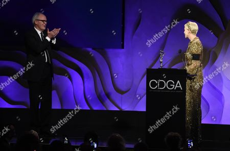 John Lithgow, Charlize Theron. Presenter John Lithgow, left, blows a kiss to actress Charlize Theron as she accepts the Spotlight Award during the 22nd Annual Costume Designers Guild Awards at the Beverly Hilton, in Beverly Hills, Calif