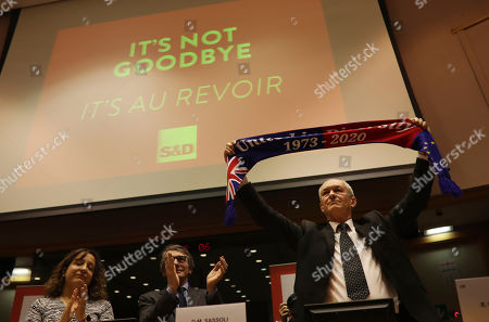 British MEP Richard Corbett holds up a scarf during a ceremony prior to the vote on the UK's withdrawal from the EU, the final legislative step in the Brexit proceedings, at the European Parliament in Brussels, . The U.K. is due to leave the EU on Friday, Jan. 31, 2020, the first nation in the bloc to do so