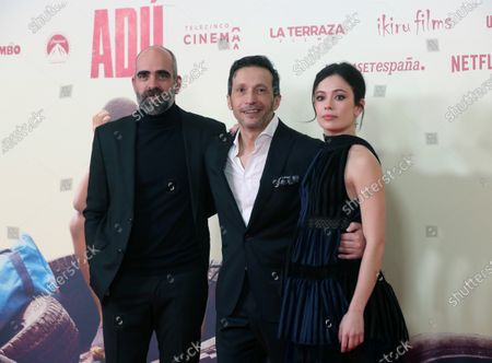 Salvador Calvo (C) poses with Spanish cast actors Luis Tosar (L) and Anna Castillo (R) pose as they arrive to the presentation of the film 'Adu' in Madrid, Spain, 28 January 2020 (issued 29 January 2020).  The film, directed by Spanish director Salvador Calvo, narrates the drama behind migration in Melilla, Spanish enclave on the north of Africa.