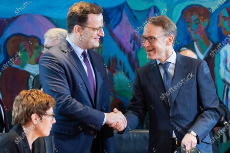 Stock Image of (L-R) Minister of Defence Annegret Kramp-Karrenbauer, Minister of Health Jens Spahn and President of German Deutsche Bundesbank Jens Weidmann, talk during a cabinet meeting at the German chancellery in Berlin, Germany, 29 January 2020. The cabinet of the German government meets on a regular basis.