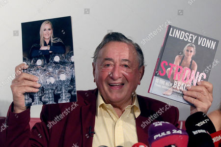 Stock Image of Austrian businessman Richard Lugner presents a photo and a book of former ski star Lindsey Vonn, of United States, who will be his special guest at this year's Opera Ball during a news conference in Vienna, Austria