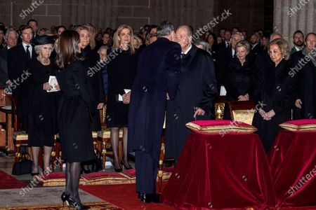 Spain's King Felipe VI (C-L) greets his father, Emeritus King Juan Carlos I (c-R), as Queen Letizia (2-L) and Emeritus Queen Sofia (R, front), look on, upon their arrival to attend the funeral of Spanish princess Pilar de Borbon, Duchess of Badajoz and Monarch' aunt, at the Real Monasterio de San Lorenzo basilica, in El Escorial, outside Madrid, Spain, 29 January 2020. More than 200 people attend the funeral, held 21 days after the death of the princess at 83.