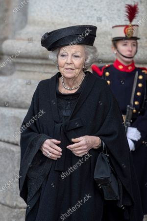 Stock Picture of Dutch Princess Beatrix (C) leaves after she attended the funeral of Spanish princess Pilar de Borbon, Duchess of Badajoz and Spain's Emeritus King Juan Carlos I's sister, at the Real Monasterio de San Lorenzo basilica, in El Escorial, outside Madrid, Spain, 29 January 2020. More than 200 people attend the funeral, held 21 days after the death of the princess at 83.