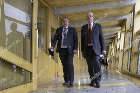 """Scottish Government Debate, Recognising Scotland in Europe - Graeme Dey, Minister for Parliamentary Business and Veterans, and Michael Russell, Cabinet Secretary for Government Business and Constitutional Relations or """"Brexit Minister"""", make their way to the Debating Chamber."""