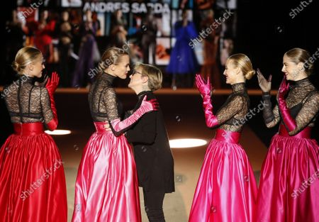 Stock Photo of Spanish models (L-R) Judith Masco, Veronica Blume, Vanessa Lorenzo and Martina Klein greet Spanish designer Nuria Sarda (C) after presenting 2020/2021 autumn-winter's creations for Andres Sarda lingerie brand as part of Mercedes-Benz Madrid Fashion Week 2020 (MBFWMadrid), held at Ifema pavilion in Madrid, Spain, 29 January 2020.