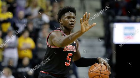 Georgia's Anthony Edwards dribbles during the first half of an NCAA college basketball game against Missouri, in Columbia, Mo