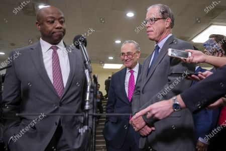Republican Senators Tim Scott (L) of South Carolina and Mike Braun (R) of Indiana speak as Democratic Senate Minority Leader Chuck Schumer (C) during a recess in the proceedings during the second week of the impeachment trial of US President Donald Trump in the Senate at the US Capitol in Washington, DC, USA, 29 January 2020.