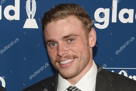 """Matthew Wilkas, Gus Kenworthy. Gus Kenworthy arrives at the 29th annual GLAAD Media Awards at the Beverly Hilton Hotel in Beverly Hills, Calif. These days, freestyle skier Gus Kenworthy is one tough act to follow. His talents have him starring in a variety of roles both on and off the slopes. He's an actor (recently appearing in """"American Horror Story: 1984""""), gay-rights advocate (he came out in 2015) and friend to animals (rescuing stray dogs). Of course, he's also an innovative slopestyle/halfpipe competitor who recently switched countries and will now represent Britain (to honor his mom"""