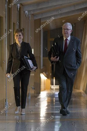 """Scottish Government Debate, Scotland's Future - Nicola Sturgeon, First Minister of Scotland and Leader of the Scottish National Party (SNP), and Michael Russell, Cabinet Secretary for Government Business and Constitutional Relations or """"Brexit Minister"""", make their way to the Debating Chamber."""