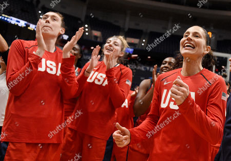 Sue Bird, Breanna Stewart, Katie Lous Samuelson. United States' Sue Bird, right, with Breanna Stewart, left, and Katie Lou Samuelson at the end of an exhibition basketball game, in Hartford, Conn