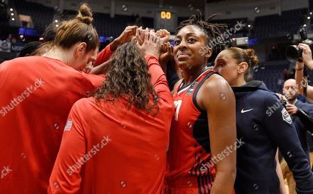 United States' Nneka Ogwumike with her team at the end of an exhibition basketball game, in Hartford, Conn