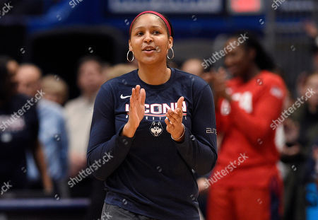 Former Connecticut player and Minnesota Lynx Maya Moore, is announced for a ceremony before a basketball game, in Hartford, Conn