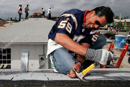Manny de Zarraga, Donnie Edwards. San Diego Chargers' Donnie Edwards pulls a nail out while working on home while volunteering as part of the Super Bowl XLI Community Impact Program in the Liberty City area of Miami. The former Chargers and Chiefs linebacker is the recipient of the NFL's 2019 Salute to Service Award. The award was created to acknowledge the exceptional efforts by members of the NFL community to honor and support members of the military community. Edwards will be recognized Saturday night at NFL Honors, when The Associated Press presents its individual league awards