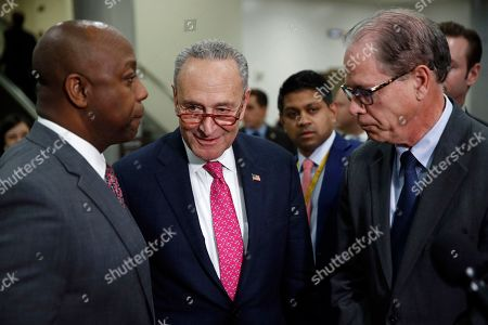 Chuck Schumer, Tim Scott, Mike Braun. Senate Minority Leader Sen. Chuck Schumer of N.Y., center, steps up to a microphone as Sen. Tim Scott, R-S.C., left, and Sen. Mike Braun, R-Ind., finish speaking with reporters during the impeachment trial of President Donald Trump on charges of abuse of power and obstruction of Congress on Capitol Hill in Washington