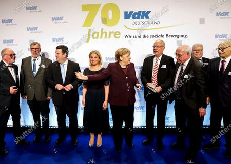 The German Chancellor Angela Merkel (C) gestures next to the President of the VdK Deutschland, Verena Bentele (L), the Minister of Labour and Social Affairs Hubertus Heil (3-L) during the 70 anniversary event of the welfare organisation VdK Deutschland in Berlin, Germany, 29 January 2020. The Sozialverband VdK Deutschland is committed to the needs of handicapped, chronically ill and elderly people and offers patients offers comprehensive information on barrier-free travelling.