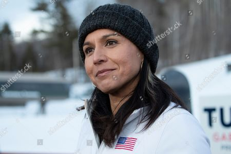 Democratic presidential candidate Rep. Tulsi Gabbard, D-Hawaii, speaks to reporters after snowboarding with supporters and staff at Cranmore Mountain Resort, in North Conway, N.H