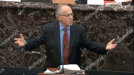 In this image from video, Alan Dershowitz, an attorney for President Donald Trump answers a question during the impeachment trial against Trump in the Senate at the U.S. Capitol in Washington