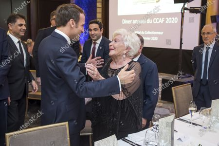 Stock Image of French President Emmanuel Macron (L) greets French Actress Line Renaud (R)  as they attend the annual dinner of CCAF (Co-ordination Council of Armenian organisations of France), in Paris, France, 29 January 2020. The CCAF is the representative body of the French-Armenian Community.