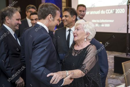 Stock Photo of French President Emmanuel Macron (L) greets French Actress Line Renaud (R)  as they attend the annual dinner of CCAF (Co-ordination Council of Armenian organisations of France), in Paris, France, 29 January 2020. The CCAF is the representative body of the French-Armenian Community.