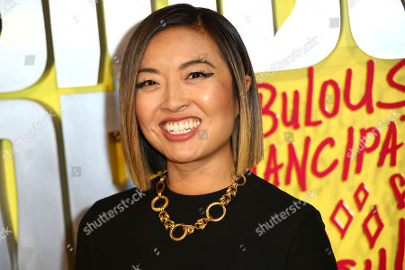 "Cathy Yan poses for photographers upon arrival at the world premiere of ""Birds of Prey"" in London"