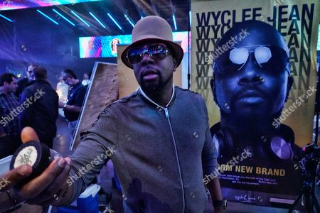 In this Thursday, Jan., 23, 2020 photo Haitian rapper, musician and actor Wyclef Jean shows off one of the products of his new cannabis line at WeedCon Wonderland Expo in the Hollywood section of Los Angeles. Wyclef Jean is the latest celebrity to launch his own cannabis product line