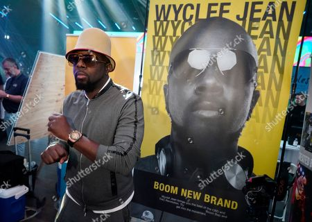 In this Thursday, Jan., 23, 2020 photo Haitian rapper, musician and actor Wyclef Jean poses for a photo while showing off his new cannabis line at WeedCon Wonderland Expo in the Hollywood section of Los Angeles. Jean is the latest celebrity to launch his own cannabis product line