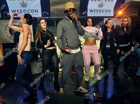 In this Thursday, Jan., 23, 2020 photo Haitian rapper, musician and actor Wyclef Jean performs at WeedCon Wonderland Expo during the launch of his cannabis brand in the Hollywood section of Los Angeles. Jean is the latest celebrity to launch his own cannabis product line