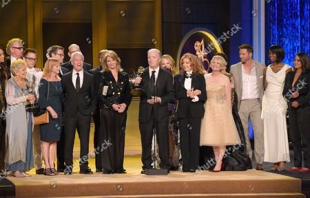 """Ken Corday, center, and the cast and crew of """"Days of Our Lives"""" accepting the award for outstanding drama series at the 45th annual Daytime Emmy Awards in Pasadena, Calif. NBC announced that their longest running series has been renewed for a record 56th season"""