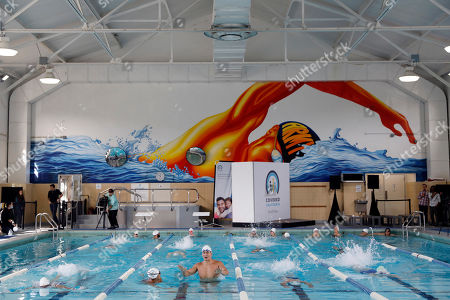 At a Covered California swim clinic, Nathan Adrian, 5-time gold medalist, leads a freestyle swim clinic to help raise awareness about California's health care options at the Presidio Community YMCA in San Francisco, Calif