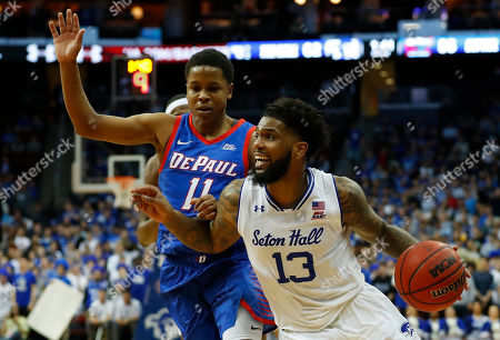 Seton Hall's Myles Powell (13) drives to the basket against DePaul's Charlie Moore (11) during the second half of an NCAA college basketball game, in Newark, N.J