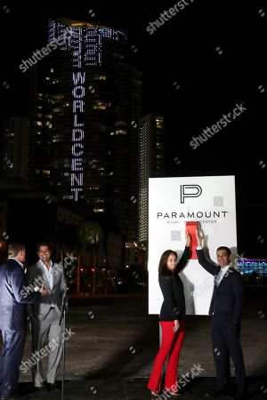 Stock Picture of Francis Suarez, Peggy Olin. Miami Mayor Francis Suarez, right, and OneWorld Properties CEO, Peggy Olin, flip the switch on Paramount Miami Worldcenter to kick-off Super Bowl 54, in Miami. The 13,400 LED lights features half-time performers Jennifer Lopez, Shakira and both Super Bowl teams