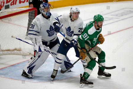 Toronto Maple Leafs goaltender Frederik Andersen (31) and defenseman Travis Dermott (23) defend against Dallas Stars center Tyler Seguin (91) during the third period of an NHL hockey game in Dallas, . Toronto defeated Dallas 5-3