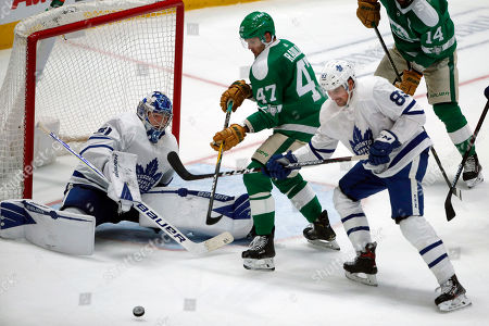 Stock Photo of Toronto Maple Leafs goaltender Frederik Andersen (31) makes a save as Dallas Stars right wing Alexander Radulov (47) and Maple Leafs defenseman Cody Ceci (83) watch the rebound during the third period of an NHL hockey game in Dallas, . Toronto defeated Dallas 5-3
