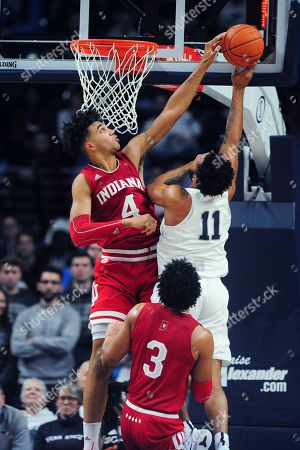 Indiana's Trayce Jackson-Davis (4) blocks a shot by Penn State's Lamar Stevens (11) during the second half of an NCAA college basketball game, in State College, Pa